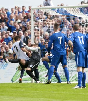 Andy Little bundles the ball over the line for the Rangers equaliser