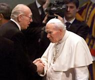 "Picture taken on February 10, 1999 shows German actor Horst Tappert (L), well known in his part as TV series inspector Derrick, shaking hands with pope John Paul II at the end of his weekly audience at the Vatican. German public broadcaster ZDF says it will stop showing reruns of the wildly popular crime show ""Derrick"" after it emerged that Tappert had belonged to Hitler's notorious Waffen SS"