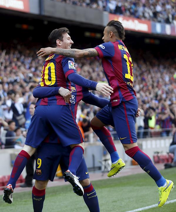Barcelona's Lionel Messi, Luis Suarez and Neymar celebrate a goal against Valencia during their Spanish first division soccer match at Camp Nou stadium in Barcelona
