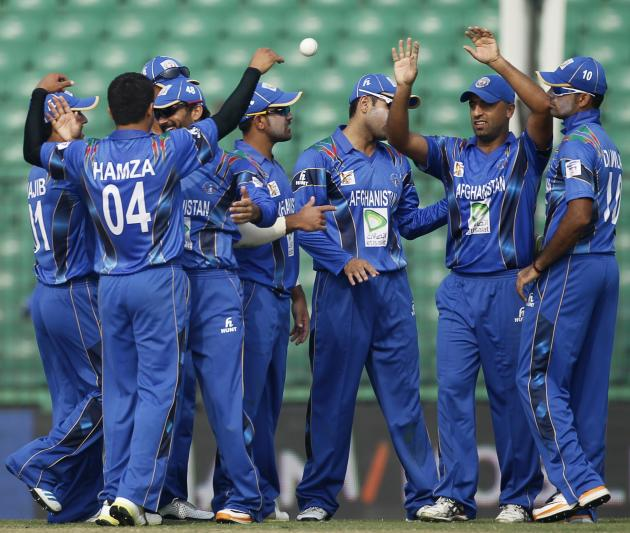 Afghanistan's fielders celebrate the dismissal of Pakistan's Sharjeel Khan during their Asia Cup 2014 ODI cricket match in Fatullah