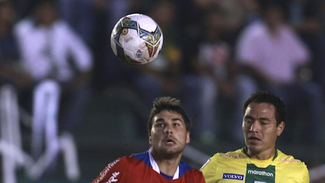 Gualberto Mujica of Bolivia's Oriente Petrolero, right, fights for the ball with Rafael Garcia of Uruguay's Nacional during a Copa Libertadores soccer match in Santa Cruz, Bolivia, Tuesday, Jan. 28, 2014
