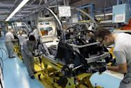 Operators work at the assembly line of a car factory in Valladolid on April 3. Spain has tipped back into recession, official data showed, grim news for a cash-strapped economy hobbled by rising debt, soaring unemployment and deeply troubled banks