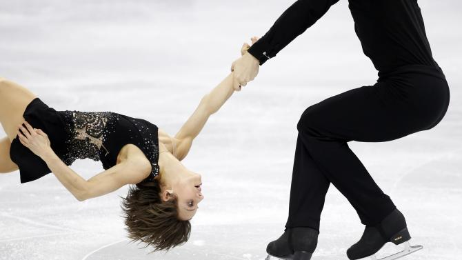 Meagan Duhamel and Eric Radford of Canada perform during the pairs free skating program competition at the ISU Four Continents Figure Skating Championships in Seoul
