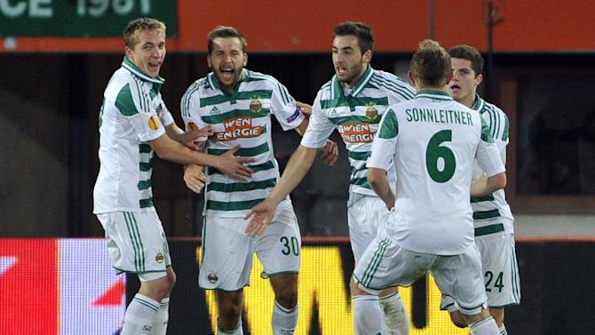 Rapid's Christopher Dibon, Guido Burgstaller, Thanos Petsos, Mario Sonnleitner and Marcel Sabitzer, from left, celebrate after scoring during their Europa League second round group G soccer match between SK Rapid Wien and FC Dynamo Kiev, in Vienna, Austria, Thursday, Oct. 3, 2013