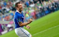Italian forward Antonio Cassano celebrates after scoring during the Euro 2012 match against Ireland on June 18. Italy put behind them a nightmare run-in both on and off the pitch to reach the Euro 2012 quarter-finals with a 2-0 defeat of Ireland