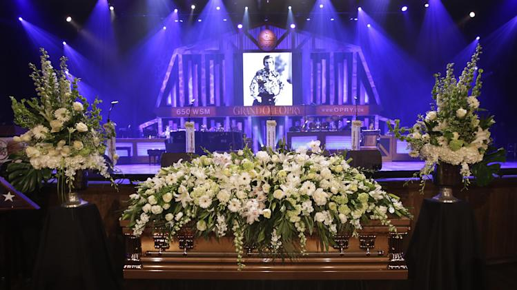 The casket for country music legend George Jones lies in the Grand Ole Opry House before his funeral on Thursday, May 2, 2013, in Nashville, Tenn. Jones, one of country music's biggest stars who had No. 1 hits in four separate decades, died April 26. He was 81. (AP Photo/Mark Humphrey, Pool)