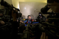 Wen Wancheng, the father of a Chinese passenger aboard the missing Malaysia Airlines Flight MH370 speaks to the journalists outside a hotel ballroom in Beijing, China, Thursday, March 20, 2014. Australian rescue officials say a search in the southern Indian Ocean for possible objects from the missing Malaysia Airlines plane has ended for the day but will resume in the morning. (AP Photo/Andy Wong)