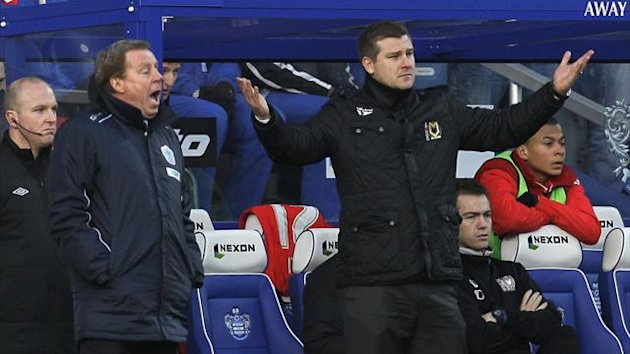 Queens Park Rangers' manager Harry Redknapp, left, and Milton Keynes Dons' manager Karl Robinson react during their English FA Cup fourth round soccer match at Loftus Road stadium, London, Saturday, Jan. 26, 2013. (AP Photo/Sang Tan)