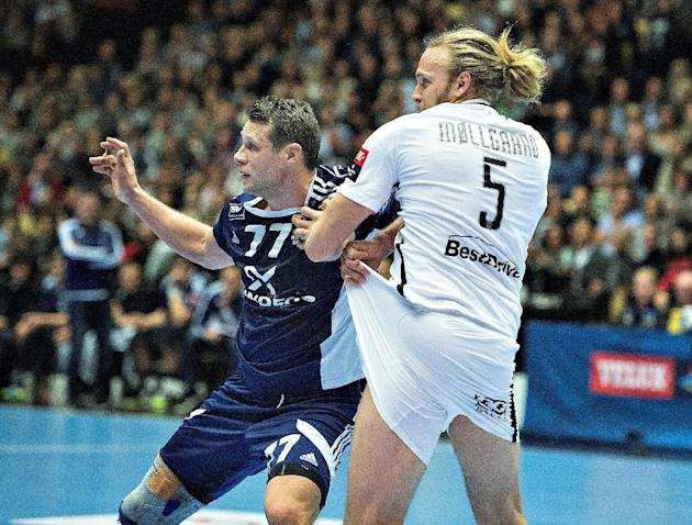 Michael V. Knudsen of Bjerringbro-Silkeborg and Henrik Mollgaard Jensen of Paris Saint-Germain in action during their Champions League Handball match in Boxen
