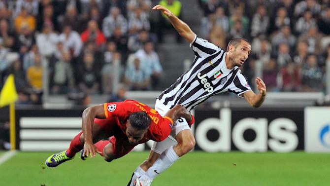 Galatasaray forward Didier Drogba, left, Ivory Coast, challenges for the ball with Juventus defender Giorgio Chiellini during the Champions League, Group B, soccer match between Juventus and Galatasaray at the Juventus stadium, in Turin, Italy, Wednesday, Oct. 2, 2013