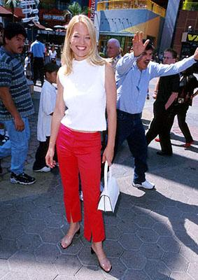 Premiere: Jeri Ryan pauses for a picture while the man behind her has apparently just been told that he looks like Dennis Farina one too many times at the Universal City premiere of Universal's The Adventures of Rocky and Bullwinkle - 6/24/2000