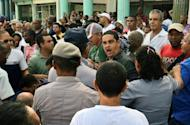 A Cuban dissident argues with a policeman during the funeral of Cuban political activist Oswaldo Paya, July 24, outside Salvador del Mundo church in Havana. Cuban police arrested dozens of dissidents at the funeral, after his daughter's vow to seek justice over his sudden death in a road accident