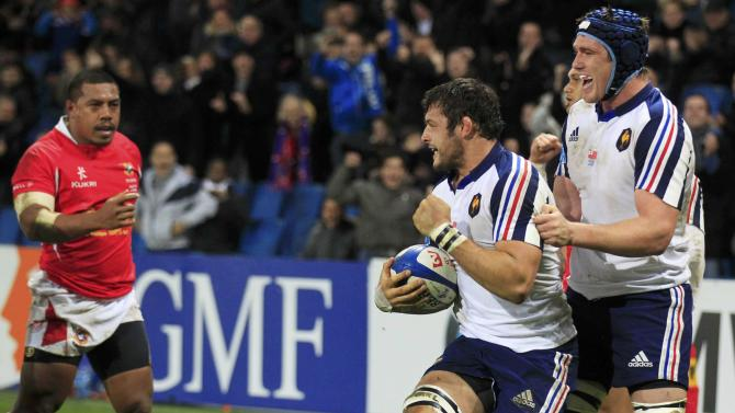 France's Damien Chouly celebrates scoring against Tonga with Bernard Leroux during their rugby union test match in Le Havre
