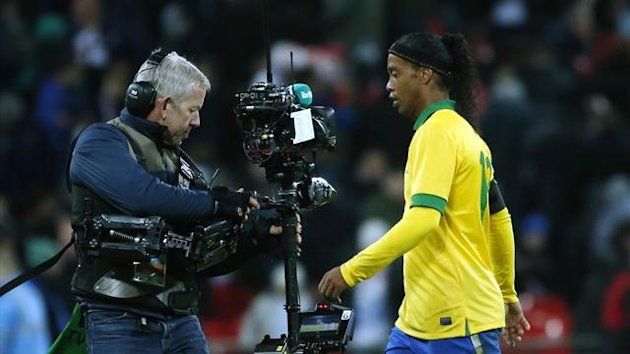 A television camera follows Brazil's Ronaldinho (R) off the pitch at halftime during the international friendly soccer match against England at Wembley stadium in London February 6, 2013 (Reuters)