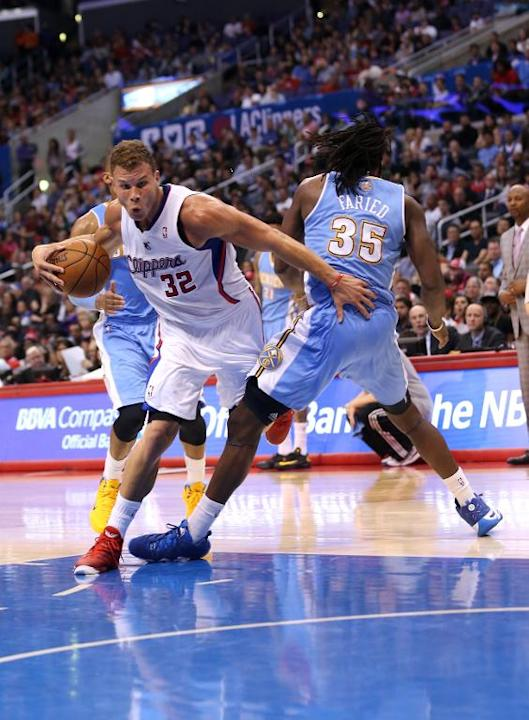 Blake Griffin of the Los Angeles Clippers is fouled as he drives against Denver Nuggets' Kenneth Faried at Staples Center on April 15, 2014
