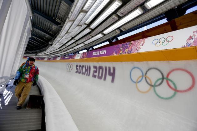 Former luger Carl Roepke, who will be announcing bobsleigh, skeleton and luge in English, walks at the Sanki Sliding Center ahead of the 2014 Winter Olympics, Monday, Feb. 3, 2014, in Krasnaya Polyana