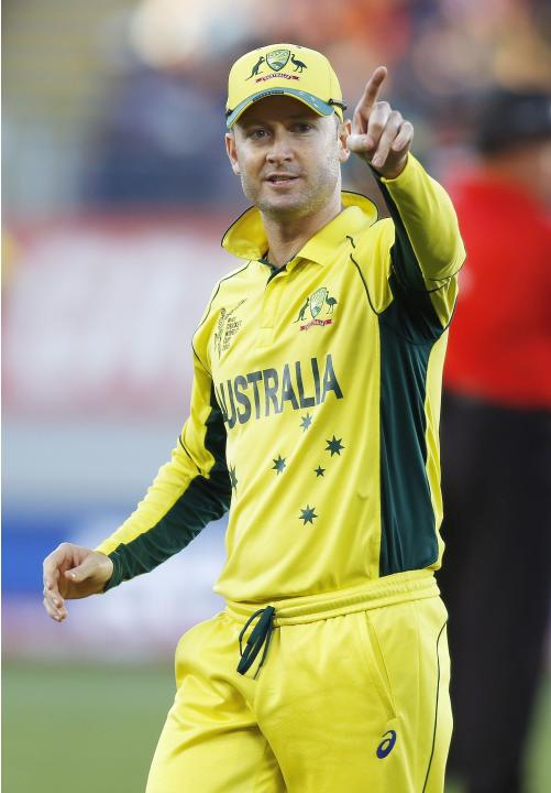 Australia's captain Clarke directs his team against New Zealand during their Cricket World Cup match in Auckland