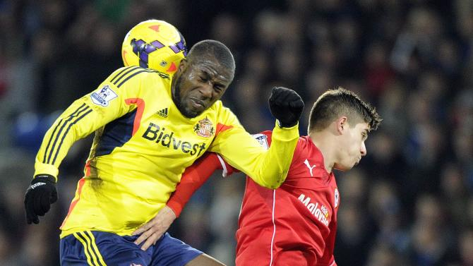 Cardiff City's John challenges Sunderland's Altidore during their English Premier League soccer match in Cardiff