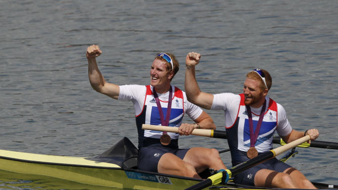 Bronze medallists George Nash and William Satch (R) of Britain pose after the medals ceremony for the Men's Pair Final event during the London 2012 Olympic Games at Eton Dorney