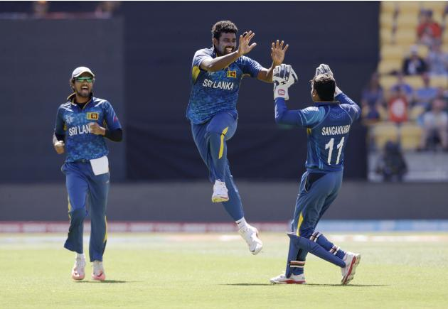 Sri Lanka's Sangakkara congratulates team mate Perera who celebrates talking the wicket of England's Morgan during their Cricket World Cup match in Wellington