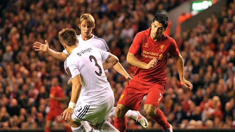 Luis Suarez, right, scored a late goal to settle the tie in Liverpool's favour