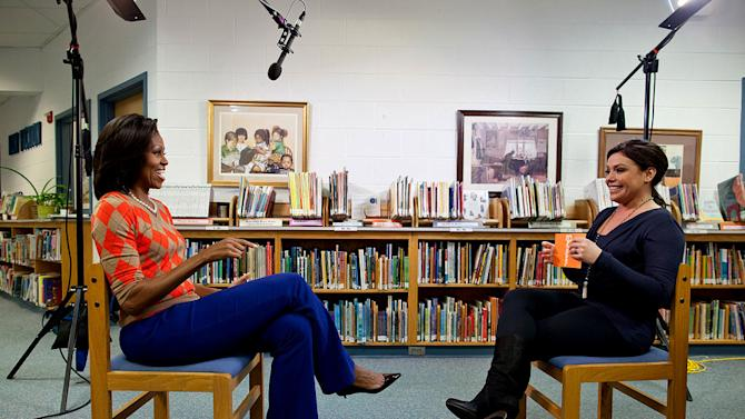 """First Lady Michelle Obama participates in an interview with celebrity chef Rachael Ray at Parklawn Elementary School in Alexandria, Va., Jan. 25, 2012 as seen on """"The Rachael Ray Show."""""""