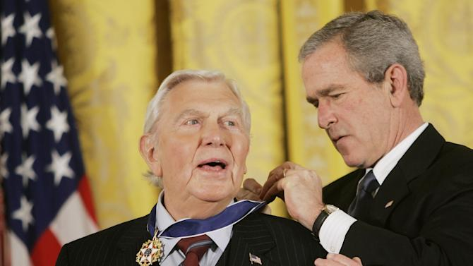 """FILE - This Nov. 9, 2005 file photo shows President Bush presenting the Presidential Medal of Freedom to actor Andy Griffith in the East Room of the White House. Griffith, whose homespun mix of humor and wisdom made """"The Andy Griffith Show"""" an enduring TV favorite, died Tuesday, July 3, 2012 in Manteo, N.C. He was 86. (AP Photo/Evan Vucci, file)"""