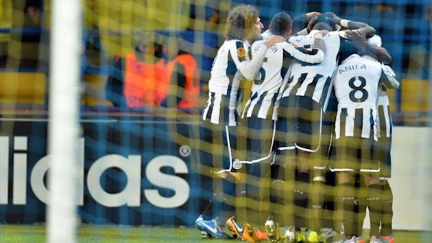 Newcastle United celebrate after scoring against FC Metalist Kharkiv during their Europa League, round of 32, match in Kharkiv on February 21, 2013.