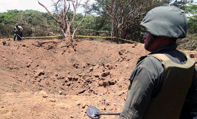 A Nicaraguan soldier checks the site where an alleged meteorite struck, in Managua, on September 7, 2014