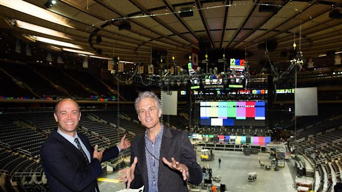 "Producers David Saltzman, left, and John Sykes speak to the media and pose for photographs as workers prepare Madison Square Garden for the ""12-12-12"" concert whose proceeds will aid the victims of Superstorm Sandy, Tuesday, Dec. 11, 2012, in New York. The Dec. 12 concert will feature artists Bon Jovi, Eric Clapton, Dave Grohl, Billy Joel, Alicia Keys, Chris Martin, The Rolling Stones, Bruce Springsteen & the E Street Band, Eddie Vedder, Roger Waters, Kanye West, The Who and Paul McCartney. (AP Photo/John Minchillo)"