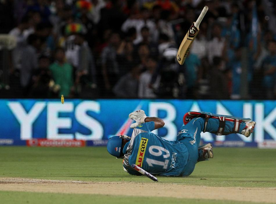 Pune Warriors player Robin Uthappa dives as he takes a quick single during match 46 of the Pepsi Indian Premier League ( IPL) 2013  between The Pune Warriors India and the Royal Challengers Bangalore