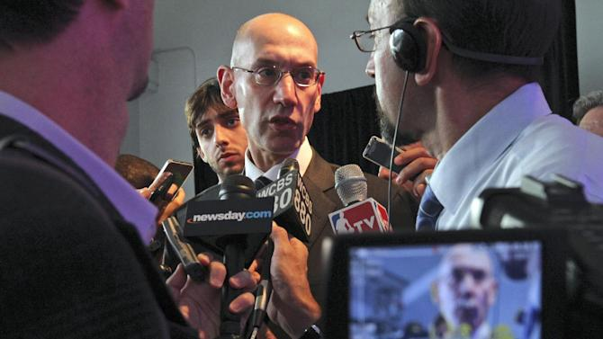 NBA deputy commissioner Adam Silver, center, is speaks with reporter during a press conference Wednesday Sept. 25, 2013, in New York, announcing the selection of the city to host the NBA All-Star game in 2015. The 64th NBA All-Star game is scheduled to be played at New York's Madison Square Garden Sunday Feb. 15, 2015 with Friday and Saturday night events being held at the Barclays Center in the Brooklyn borough of New York