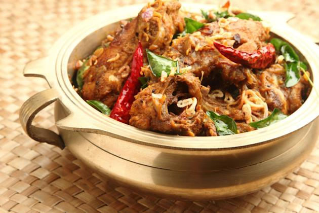 Dig into some delcious crab curry, replete with coastal flavours.