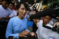 Myanmar opposition leader Aung San Suu Kyi in Yangon on April 22. Myanmar's parliament convened without Suu Kyi and newly-elected members of her party on Monday, amid a dispute over the swearing-in oath