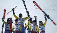 Alpine Skiing - FIS Alpine Skiing World Championships - Alpine Team Event - St. Moritz, Switzerland - 14/2/17 - (L to R) Sweden's Maria Pietilae-Holmner, Mattias Hargin, Andre Myhrer, Gustav Lundbaeck, Emelie Wikstroem and Frida Hansdotter celebrate winning bronze after the final of the parallel slalom Mixed Team event. REUTERS/Denis Balibouse