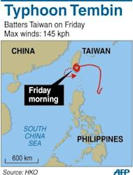 Map showing the path of Typhoon Tembin across the southern tip of Taiwan on Friday, where it toppled trees and ripped off rooftops