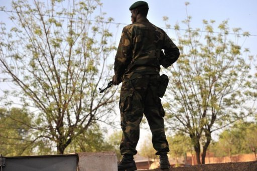 "A Malian soldier stands guard at Kati military camp near Bamako. The UN Security Council called for an immediate ceasefire and return to democracy in Mali, prompting an announcement of an end to ""military operations"" by Tuareg rebels in the north."