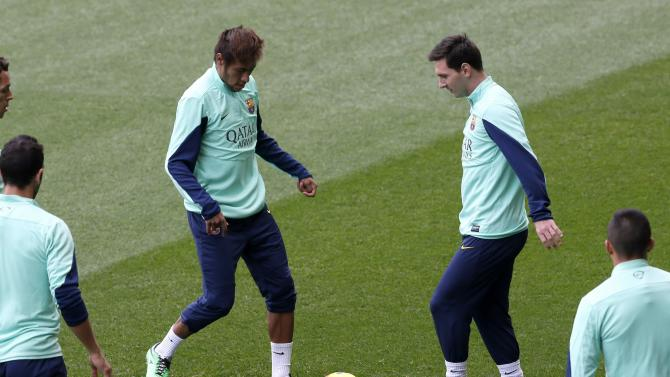 Barcelona's Neymar and Messi control the ball during an open training session at Mini stadium in Barcelona