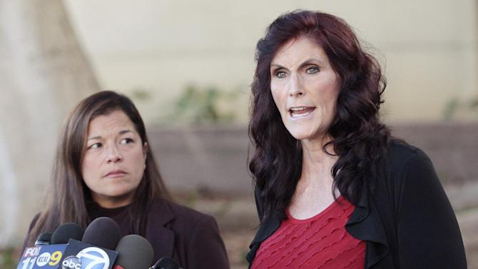"Cindy Lee Garcia, right, one of the actresses in ""Innocence of Muslims,"" and attorney M. Cris Armenta hold a news conference before a hearing at Los Angeles Superior Court in Los Angeles, Thursday, Sept. 20, 2012. Garcia is asking a judge to issue an injunction demanding the 14-minute trailer for ""Innocence of Muslims"" be pulled from YouTube. (AP Photo/Jason Redmond)"