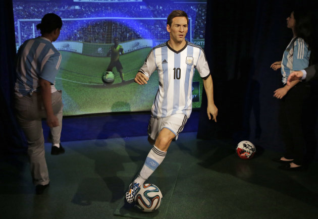 The wax figure of FC Barcelona forward Lionel Messi, wearing the #10 team Argentina jersey like the one he wore during the 2014 FIFA World Cup, is on display, Tuesday, May 19, 2015, during the unveiling at Madame Tussauds New York. Messi's figure is displayed with an interactive soccer simulator where visitors can practice their kick in a virtual soccer arena. (AP Photo/Mary Altaffer)