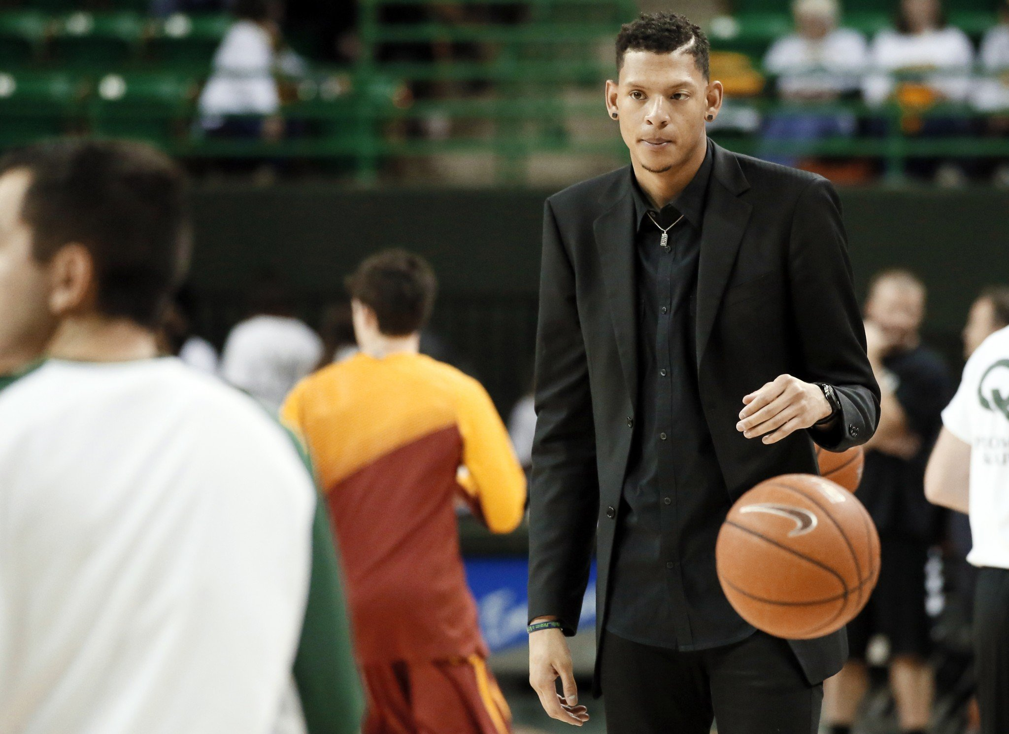 After his NBA dreams were dashed, Isaiah Austin returned to Baylor to become a student coaching assistant. Now, he's getting back on the court. (AP)