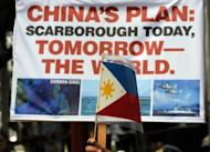 This file photo shows anti-China protesters during a rally in front of the Chinese consulate in the financial district of Manila, in May. The dispute between Manila and Beijing has intensified since April after a face-off began over the Scarborough Shoal, a rocky outcrop in the South China Sea