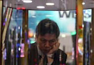 A man plays a gaming machine at the G2E Asia gaming expo in Macau on May 22. As billions of dollars pour into Asia's gleaming casinos, they are becoming the front line of a sometimes hugely lucrative battle between cheats and the house, say experts