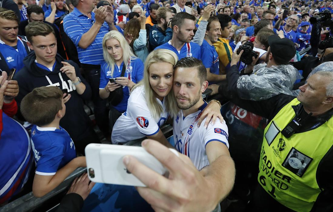 Iceland's Gylfi Sigurdsson poses for a selfie with wife Alexandra Ivarsdottir after the game