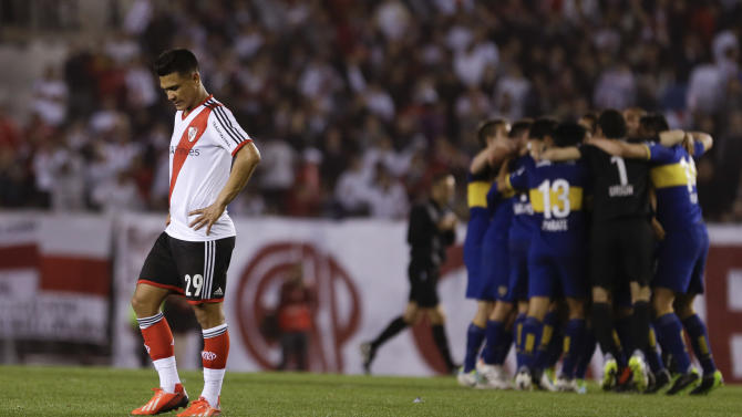 River Plate's Teofilo Gutierrez  leaves the field after an Argentina league soccer match  against Boca Juniors in Buenos Aires, Argentina, Sunday, Oct. 6, 2013. River Plate lost 1-0