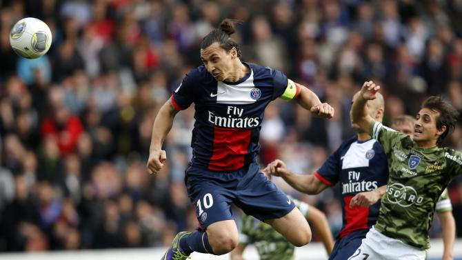 Paris St Germain's Ibrahimovic shoots and scores a goal for the team during their French Ligue 1 soccer match against Bastia at the Parc des Princes Stadium in Paris