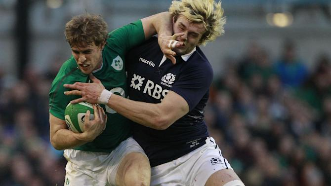 Ireland's Andrew Trimble, left, is tackled by Scotland's Richie Gray during their Six Nations Rugby Union international match at the Aviva Stadium, Dublin, Ireland, Sunday, Feb. 2, 2014. (AP Photo/Peter Morrison)