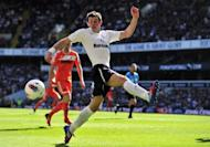 Tottenham Hotspur's Welsh defender Gareth Bale, shown at White Hart Lane in April, signed a new four-year contract with the club Wednesday. Tottenham have been without a manager since Harry Redknapp was sacked earlier this month