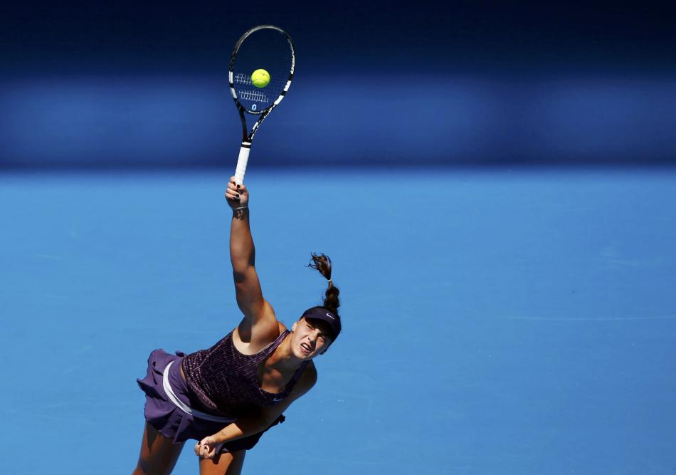 Ana Konjuh of Croatia serves to Li Na of China during their women's singles match at the Australian Open 2014 tennis tournament in Melbourne