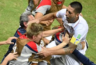 USA's Clint Dempsey celebrates with teammates during his team's draw against Portugal. (AFP)